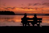 CAL PEO SUM  AB     1810117D  MRCOUPLE ON BENCH AT TWILIGHT                   ELK ISLAND NATIONAL PK     08/04© CLARENCE W. NORRIS       ALL RIGHTS RESERVEDAB_;ALBERTA;ALYS;BENCH;BOATS;CAL_PEOPLE;CALENDARS;COUPLE;ELK_ISLAND_NP;LAKES;MR_;NP_;OUTDOORS;PARKLAND;PEOPLE;PLAINS;PRAIRIES;SCENES;SIMON;SUMMER;TWILIGHT;WATER LONE PINE PHOTO               (306) 683-0889