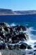 WAVES AGAINST ROCKS, HOLMAN