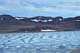 ROTTING SEA ICE AND HILLS, HOLMAN