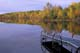 DOCK, CALM LAKE AND FALL SHORELINE, LAC LA PECHE