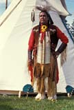 CUL NAT POW  SK     1302222D  NMR  VT     MALE POW WOW DANCER STANDING INFRONT OF TEEPEE                 SASKATOON                       0529© CLARENCE W. NORRIS      ALL RIGHTS RESERVEDABORIGINAL;CLOTHING;COSTUMES;CULTURE;DANCE;FIRST;FIRST_NATIONS;MALE;NATIONS;OUTDOORS;PEOPLE;PLAINS;POW;POW_WOW;PRAIRIES;SASKATCHEWAN;SASKATOON;SHELTERS;SK_;TEEPEES;VTL;WOWLONE PINE PHOTO              (306) 683-0889