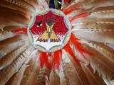 CUL NAT POW  SK  CWN02D4212D          BEADED PICTURE AND FEATHERS ON COSTUME               AT POW WOW SASKATOON                       1019© CLARENCE W. NORRIS      ALL RIGHTS RESERVEDABORIGINAL;BEADS;COSTUMES;CRAFTS;CULTURE;DANCE;FEATHERS;FIRST;FIRST_NATIONS;NATIONS;PEOPLE;PLAINS;POW;POW_WOW;PRAIRIES;SASKATCHEWAN;SASKATOON;SK_;WOWLONE PINE PHOTO              (306) 683-0889