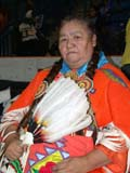 CUL NAT POW  SK  CWN02D4220D  NMR  VT        ABORIGINAL WOMEN IN POW WOW OUTFIT SASKATOON                       1019© CLARENCE W. NORRIS      ALL RIGHTS RESERVEDABORIGINAL;CLOTHING;COSTUMES;CULTURE;DANCE;ELDERS;FEATHERS;FEMALE;FIRST;FIRST_NATIONS;NATIONS;PEOPLE;PLAINS;POW;POW_WOW;PRAIRIES;SASKATCHEWAN;SASKATOON;SK_;VTL;WOWLONE PINE PHOTO              (306) 683-0889