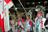 CUL NAT POW  SK  WDS05E8256DX    MALE POW WOW DANCERS HOLDING FLAGS2005 CULTURAL CELEBRATION & POW WOWSASKATOON                     ....© WAYNE SHIELS               ALL RIGHTS RESERVEDABORIGINAL;COSTUMES;CULTURE;DANCE;ELDERS;FIRST;FIRST_NATIONS;FLAGS;HEADDRESSES;MALE;NATIONS;PEOPLE;PLAINS;POW;POW_WOW;PRAIRIES;SASKATCHEWAN;SASKATOON;SK_;WOWLONE PINE PHOTO              (306) 683-0889