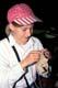 GIRL SEWING ANIMAL SKIN, FORT MCLEOD