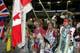 MALE POW WOW DANCERS HOLDING FLAGS, SASKATOON