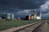 ELE CLO MIS  SK  CWN0203831D                  STORM CLOUDS OVER ELEVATOR AND TRAIN TRACKSDUCK LAKE                          07/01© CLARENCE W. NORRIS      ALL RIGHTS RESERVEDBUILDINGS;CLOUDS;ELEMENTS;DUCK_LAKE;ELEVATORS;GRAVEL;PLAINS;PRAIRIES;RURAL;SASKATCHEWAN;SCENES;SK_;SKY;STORM;SUMMER;TRAINS;TRANSPORTATION;WEATHERLONE PINE PHOTO                  (306) 683-0889