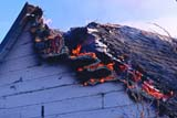 ELE FIR BUI  SK     2201221DFIRE BURNING EDGE OF ROOFST. DENIS                                 02/23© CLARENCE W. NORRIS           ALL RIGHTS RESERVEDBUILDINGS;ELEMENTS;FIRE;HEAT;HOMES;INSURANCE;PLAINS;PRAIRIES;SAFETY;SASKATCHEWAN;SK_;ST_DENIS;STRUCTURES;WINTERLONE PINE PHOTO                  (306) 683-0889