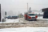ELE SNO MIS  AB  KJM0302310D    FIRE ENGINE GUARDING DOWNED POWER LINE IN SNOWSTORMTHREE HILLS                       04/..© KEVIN MORRIS                ALL RIGHTS RESERVEDAB_;ALBERTA;AUTOS;BLIZZARDS;ELEMENTS;FIRE_ENGINES;FIREFIGHTERS;OCCUPATIONS;PLAINS;PRAIRIES;SLUSH;SNOW;SNOWSTORM;SPRING;STREETS;THREE_HILLS;TOWNSLONE PINE PHOTO              (306) 683-0889