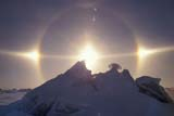 ELE SUN MIS  MB  JLB1800920DSUNDOGS AND SOLAR HALOCHURCHILL RIVER ICE RIDGECHURCHILL                            02© JOHN L. BYKERK                ALL RIGHTS RESERVEDARCTIC;CHURCHILL;CHURCHILL_RIVER;ELEMENTS;MANITOBA;MB_;ICE;SCENES;SKY;SUNDOGS;WINTERLONE PINE PHOTO              (306) 683-0889