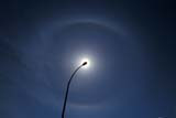 ELE SUN MIS  YT  PEH1000427DSOLAR HALO AROUND LIGHT STANDARDSOUTHEY                          06© PHIL HOFFMAN               ALL RIGHTS RESERVEDELEMENTS;LAMPPOSTS;PLAINS;PRAIRIES;SASKATCHEWAN;SK_;SKY;SOLAR_HALOS;SOUTHEY;STREET_LAMPS;SUMMER;SUN;WEATHERLONE PINE PHOTO              (306) 683-0889