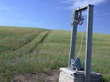 ELE WAT MIS  SK  CWN02D3408D    WATER WELL AND TRAIL THROUGH SUMMER FIELDST. DENIS                                09/. .© CLARENCE W. NORRIS          ALL RIGHTS RESERVEDELEMENTS;FARMING;FIELDS;PIONEERS;PLAINS;PRAIRIES;RURAL;SASKATCHEWAN;SCENES;SK_;ST_DENIS;STRUCTURES;TRAILS;WATER;WELLSLONE PINE PHOTO                  (306) 683-0889