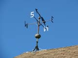 ELE WIN MIS  SK  LJN08A0917DX WEATHER VANE AND LIGHTNING ROD ON ROOFSASKATOON FORESTRY FARM PARK AND ZOOSASKATOON                            08© LAURA NORRIS                     ALL RIGHTS RESERVEDELEMENTS;FARMING;LIGHTNING_RODS;PLAINS;PRAIRIES;RURAL;SASKATCHEWAN;SASKATOON;SASKATOON_FORESTRY_FARM;STRUCTURES;SUMMER;WEATHER;WEATHER_VANES;WINDLONE PINE PHOTO              (306) 683-0889