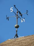 ELE WIN MIS  SK  LJN08A0918DX  VTWEATHER VANE AND LIGHTNING ROD ON ROOFSASKATOON FORESTRY FARM PARK AND ZOOSASKATOON                            08© LAURA NORRIS                     ALL RIGHTS RESERVEDELEMENTS;FARMING;LIGHTNING_RODS;PLAINS;PRAIRIES;RURAL;SASKATCHEWAN;SASKATOON;SASKATOON_FORESTRY_FARM;STRUCTURES;SUMMER;VTL;WEATHER;WEATHER_VANES;WINDLONE PINE PHOTO              (306) 683-0889