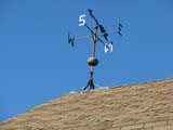 ELE WIN MIS  SK  LJN08A0919DX WEATHER VANE AND LIGHTNING ROD ON ROOFSASKATOON FORESTRY FARM PARK AND ZOOSASKATOON                            08© LAURA NORRIS                     ALL RIGHTS RESERVEDELEMENTS;FARMING;LIGHTNING_RODS;PLAINS;PRAIRIES;RURAL;SASKATCHEWAN;SASKATOON;SASKATOON_FORESTRY_FARM;STRUCTURES;SUMMER;WEATHER;WEATHER_VANES;WINDLONE PINE PHOTO              (306) 683-0889