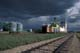 STORM CLOUDS OVER ELEVATOR AND TRAIN TRACKS, DUCK LAKE