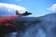 FIREFIGHTER PLANE DROPPING CHEMICAL RETARDANT ON FOREST FIRE, WHITEHORSE