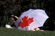 PERSON UNDER CANADA UMBRELLA, SASKATOON