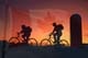 CYCLISTS AND SILO AT SUNSET WITH CANADIAN FLAG LAID OVER, OSLER