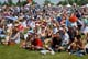 CROWDS SITTING ON GRASS, SASKATOON