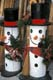 SNOWMEN FENCEPOSTS ON DISPLAY FOR CHRISTMAS, ST. JACOB'S