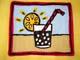 SUNSHINE AND STRAW IN DRINK ON NAPKIN, SASKATOON