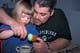 GIRL COLOURING EASTER EGGS WITH DAD, SASKATOON