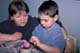 BOY COLOURING EASTER EGGS WITH MOM, SASKATOON