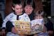 MOM READING EASTER BOOK TO CHILDREN, SASKATOON