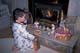 BOY PLACING CARROTS ON HEARTH, SASKATOON
