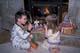 BOY AND GIRL PLACING CARROTS ON HEARTH, SASKATOON