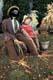 HALLOWE'EN MAN AND WOMAN ON FRONT LAWN, SASKATOON