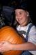 GIRL IN WITCH'S HAT HOLDING PUMPKIN, SASKATOON