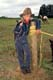 COWGIRL LEANING ON POST, DUCK LAKE