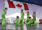 EVE CAN DAY SK  WDS06B3800DXCHINESE DANCERSCANADA DAY CELEBRATIONSSASKATOON                      071© WAYNE SHIELS                ALL RIGHTS RESERVEDCANADA_DAY;CHILDREN;CHINESE;CULTURE;DANCE;EVENTS;FEMALE;GIRL;OUTDOORS;PEOPLE;PLAINS;PRAIRIES;SASKATCHEWAN;SASKATOON;SK_;SUMMERLONE PINE PHOTO              (306) 683-0889
