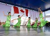 EVE CAN DAY SK  WDS06B3801DXCHINESE DANCERSCANADA DAY CELEBRATIONSSASKATOON                      071© WAYNE SHIELS               ALL RIGHTS RESERVEDCANADA_DAY;CHILDREN;CHINESE;CULTURE;DANCE;EVENTS;FEMALE;GIRL;OUTDOORS;PEOPLE;PLAINS;PRAIRIES;SASKATCHEWAN;SASKATOON;SK_;SUMMERLONE PINE PHOTO              (306) 683-0889