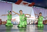 EVE CAN DAY SK  WDS06B3802DXCHINESE DANCERSCANADA DAY CELEBRATIONSSASKATOON                      071© WAYNE SHIELS              ALL RIGHTS RESERVEDCANADA_DAY;CHILDREN;CHINESE;CULTURE;DANCE;EVENTS;FEMALE;GIRL;OUTDOORS;PEOPLE;PLAINS;PRAIRIES;SASKATCHEWAN;SASKATOON;SK_;SUMMERLONE PINE PHOTO              (306) 683-0889