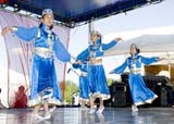 EVE CAN DAY SK  WDS06B3806DXCHINESE DANCERSCANADA DAY CELEBRATIONSSASKATOON                      071© WAYNE SHIELS                ALL RIGHTS RESERVEDCANADA_DAY;CHILDREN;CHINESE;CULTURE;DANCE;EVENTS;FEMALE;OUTDOORS;PEOPLE;PLAINS;PRAIRIES;SASKATCHEWAN;SASKATOON;SK_;SUMMERLONE PINE PHOTO              (306) 683-0889