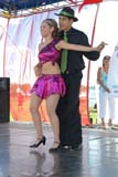 EVE CAN DAY SK  WDS06B4349DX  VTLATIN DANCERSCANADA DAY CELEBRATIONSSASKATOON                      071© WAYNE SHIELS                ALL RIGHTS RESERVEDCANADA_DAY;CO-ED;COUPLE;CULTURE;DANCE;EVENTS;LATIN;OUTDOORS;PEOPLE;PLAINS;PRAIRIES;SASKATCHEWAN;SASKATOON;SK_;SUMMER;VTLLONE PINE PHOTO              (306) 683-0889