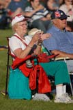 EVE CAN DAY SK  WDS06B4420DX  VTSENIOR COUPLECANADA DAY CELEBRATIONSSASKATOON                      071© WAYNE SHIELS                ALL RIGHTS RESERVEDCANADA_DAY;CHAIRS;CLAPPING;CO_ED;COUPLE;EVENTS;LAWN;OUTDOORS;PEOPLE;PLAINS;PRAIRIES;SASKATCHEWAN;SASKATOON;SENIORS;SK_;SPECTATORS;SUMMER;VTLLONE PINE PHOTO              (306) 683-0889