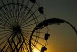 EVE CHI NEW  SK     0710110D   FERRIS WHEEL AT SUNSETSASKATOON                       06/..© CLARENCE W. NORRIS      ALL RIGHTS RESERVEDCARNIVAL;EVENTS;FAIRS;FERRIS_WHEELS;PLAINS;PRAIRIES;RIDES;SASKATCHEWAN;SASKATOON;SILHOUETTE;SK_;SUMMER;SUNSETS LONE PINE PHOTO              (306) 683-0889