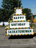 EVE CEN SAS  SK  LJN05A0673DX  VTHAPPY BIRTHDAY FLOATSASKATCHEWAN CENTENNIALPREECEVILLE                      07..© LAURA NORRIS               ALL RIGHTS RESERVEDCENTENNIAL;EVENTS;PLAINS;PRAIRIES;PREECEVILLE;SASKATCHEWAN;SK_;SUMMER;VTLLONE PINE PHOTO             (306) 683-0889
