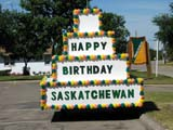 EVE CEN SAS  SK  LJN05A0672DX  VTHAPPY BIRTHDAY FLOATSASKATCHEWAN CENTENNIALPREECEVILLE                      07..© LAURA NORRIS               ALL RIGHTS RESERVEDCENTENNIAL;EVENTS;PLAINS;PRAIRIES;PREECEVILLE;SASKATCHEWAN;SK_;SUMMERLONE PINE PHOTO             (306) 683-0889