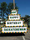 EVE CEN SAS  SK  LJN05A0677DX  VTHAPPY BIRTHDAY FLOATSASKATCHEWAN CENTENNIALPREECEVILLE                      07..© LAURA NORRIS               ALL RIGHTS RESERVEDCENTENNIAL;EVENTS;PLAINS;PRAIRIES;PREECEVILLE;SASKATCHEWAN;SK_;SUMMER;VTLLONE PINE PHOTO             (306) 683-0889