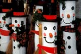 EVE CHR MIS  ON  BMM1001032D     WOODEN SNOWMENST. JACOBS                        01/..© BEV McMULLEN                ALL RIGHTS RESERVEDART;CENTRAL;CHRISTMAS;DECORATIONS;EVENTS;HOLIDAYS;ON_;ONTARIO;SNOWMEN;ST_JACOBS;WINTERLONE PINE PHOTO              (306) 683-0889