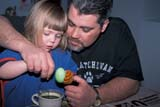 EVE EAS MIS  SK  CWN2201912D  MR #354     GIRL COLOURING EASTER EGGS WITH DADSASKATOON                       03/30© CLARENCE W. NORRIS      ALL RIGHTS RESERVEDADULTS;CHILDREN;CRAFTS;DYE;EASTER;EGGS;EVENTS;FAMILIES;GIRL;MALE;MR_;PARENTS;PEOPLE;PLAINS;PRAIRIES;SASKATCHEWAN;SASKATOON;SK_;SPRINGLONE PINE PHOTO              (306) 683-0889