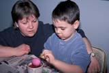 EVE EAS MIS  SK  CWN2201916D  MR #354   BOY COLOURING EASTER EGGS WITH MOMSASKATOON                       03/30© CLARENCE W. NORRIS      ALL RIGHTS RESERVEDADULTS;BOY;CHILDREN;CRAFTS;DYE;EASTER;EGGS;EVENTS;FAMILIES;FEMALE;MR_;PARENTS;PEOPLE;PLAINS;PRAIRIES;SASKATCHEWAN;SASKATOON;SK_;SPRINGLONE PINE PHOTO              (306) 683-0889