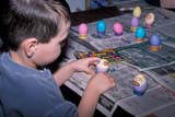 EVE EAS MIS  SK  CWN2201924D  MR #354   BOY PUTTING STICKERS ON EASTER EGGSSASKATOON                       03/30© CLARENCE W. NORRIS      ALL RIGHTS RESERVEDBOY;CHILDREN;CRAFTS;EASTER;EGGS;EVENTS;MR_;PEOPLE;PLAINS;PRAIRIES;SASKATCHEWAN;SASKATOON;SK_;STICKERS;SPRINGLONE PINE PHOTO              (306) 683-0889