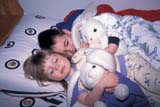 EVE EAS MIS  SK  CWN2202012D  MR #354   BOY AND GIRL LAYING IN BED WITH RABBITSSASKATOON                       03/30© CLARENCE W. NORRIS      ALL RIGHTS RESERVEDBEDTIME;BOY;CHILDREN;CO_ED;COUPLE;EASTER;EVENTS;FAMILIES;GIRL;MR_;PEOPLE;PLAINS;PRAIRIES;RABBITS;SASKATCHEWAN;SASKATOON;SK_;SLEEPING;SPRING;TOYSLONE PINE PHOTO              (306) 683-0889