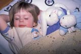 EVE EAS MIS  SK  CWN2202017D  MR #354   GIRL WITH STUFFED ANIMALS LAYING IN BEDSASKATOON                       03/30© CLARENCE W. NORRIS      ALL RIGHTS RESERVEDANIMALS;BEDTIME;BUNNIES;CHILDREN;EASTER;EVENTS;GIRL;LAMBS;MR_;PEOPLE;PLAINS;PRAIRIES;RABBITS;SASKATCHEWAN;SASKATOON;SK_;TOYSLONE PINE PHOTO              (306) 683-0889